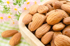 Almond in wooden cup. stock photography