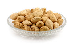 Almonds. Yellow almonds with white background Stock Image