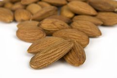 Almonds. Closeup image of almonds on white background stock photos