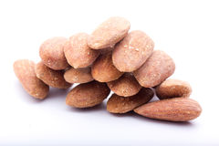 Almonds. Roasted almonds with salt on a white background royalty free stock image