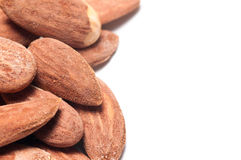 Almonds. Pile of salted and toasted almonds with copy space on a white background Royalty Free Stock Image