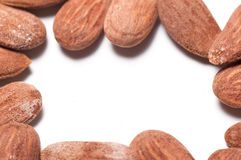Almonds. Group of almonds on a white background with copyspace in the middle Stock Photo