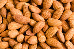 Almonds. Pile of almonds close-up as background Royalty Free Stock Photography