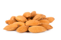 Almonds. Closeup view of almonds over white background Royalty Free Stock Images