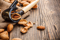 Almonds. Composition from almonds on the rustic wooden board Stock Photos