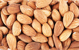 Almonds. Pile of almonds closeup as background Royalty Free Stock Photo