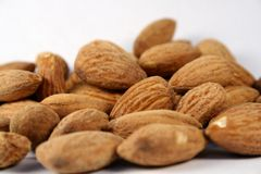 Almonds. Lying on a white surface Stock Photo