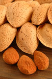 Almonds. Group of almonds with background of wood Royalty Free Stock Photography