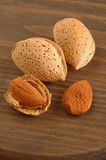 Almonds. Group of almonds with background of wood Stock Images