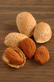 Almonds. Group of almonds with background of wood Royalty Free Stock Images