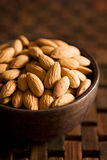 Almonds. Close-up of a bowl with almonds. Shallow DOF Royalty Free Stock Images