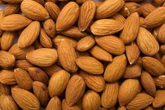 Almonds. The cleared almond nut to scatter on a surface royalty free stock images