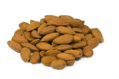 Almonds. Brown almods on white background royalty free stock photography