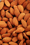 Almonds. Natural form food: almonds background Royalty Free Stock Image