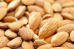 Almonds. Almonds handful have been photographed with small DOF Royalty Free Stock Image
