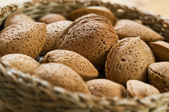 Almonds. A basket filled with almonds Stock Photo
