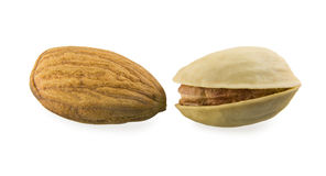 Almonds against a pistachio. Image on white backgound Stock Photos
