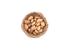 Almonds,almond group, almonds in nest on over white background. Top view Royalty Free Stock Photos