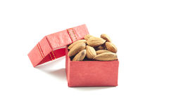 Almonds,almond group, almonds in red gift box on over white back. Almonds,almond group, almonds in red gift box on over white background Stock Photos
