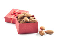 Almonds,almond group, almonds in red gift box on over white back. Almonds,almond group, almonds in red gift box on over white background Royalty Free Stock Photography