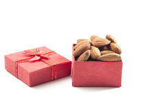 Almonds,almond group, almonds in red gift box on over white back. Almonds,almond group, almonds in red gift box on over white background Stock Images