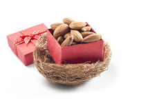 Almonds,almond group, almonds in red gift box on over white back. Almonds,almond group, almonds in red gift box on over white background Royalty Free Stock Photos
