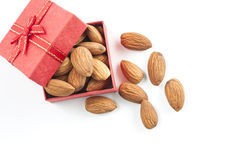 Almonds,almond group, almonds in red gift box on over white back. Ground. top view Royalty Free Stock Images