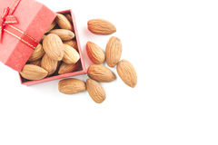 Almonds,almond group, almonds in red gift box on over white back. Ground. top view Stock Photos