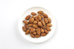 Almonds,almond group, almonds in white dish on over white backgr. Ound Stock Photo