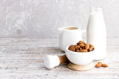 Almonds and almond milk. On a light background stock photo