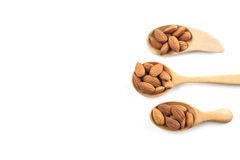 Almonds, almonds on wooden spoon isolated over white background. Top view Royalty Free Stock Photo