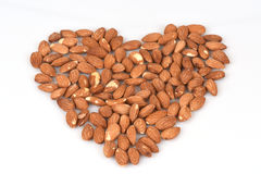 Almonds arranged in a heart shape. Stock Photography