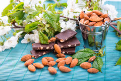 Almonds in a backet with pieces of chocolate with nuts Stock Photo