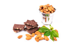 Almonds in a backet with pieces of chocolate with nuts Royalty Free Stock Images