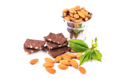 Almonds in a backet with pieces of chocolate with nuts Stock Image