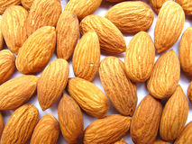 Almonds Background. Close up of some golden sweet almonds Royalty Free Stock Photos
