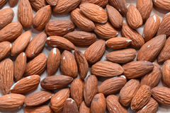 Almonds background macro view from above Royalty Free Stock Photos