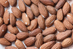 Almonds background macro view from above Royalty Free Stock Photo