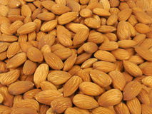 Almonds. Background of almonds for presentations, recipe ideas and other Royalty Free Stock Photo