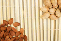 Almonds in a background tablecloth, snacks of nuts. In shell and seeds Royalty Free Stock Photography