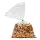 Almonds in Bag. Almonds in plastic bag isolated on white with clipping path Royalty Free Stock Photography