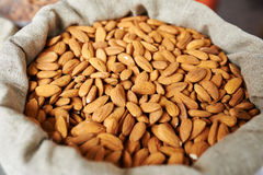 Almonds in a bag Royalty Free Stock Images