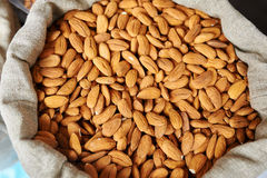 Almonds in a bag Royalty Free Stock Photos