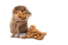 Almonds in bag isolated on white background. Stock Image