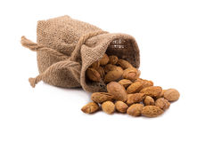 Almonds in bag isolated on white background. Royalty Free Stock Photo