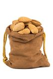 Almonds and a bag on white Royalty Free Stock Images