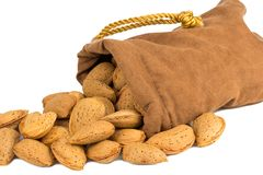 Almonds and a bag on white Royalty Free Stock Photography