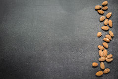 Almonds. On the banks of the table Royalty Free Stock Photography