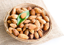 Almonds in basket. Stock Photo