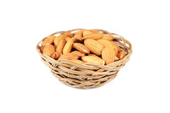 Almonds in basket isolated on white Royalty Free Stock Photography